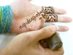 Henna tattoo using a Professional applicator bottle with metal tip, also known as a jac bottle