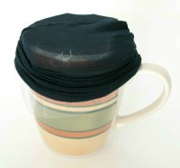 Mug with carrot bag inside and nylon over the top for straining henna.
