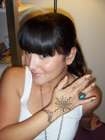 Henna for style!  The gorgeous Puerto Rican woman wears henna as an extension of her personal style!