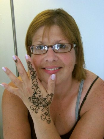 Olrando first time henna for positive energy flow with a traditional henna design.